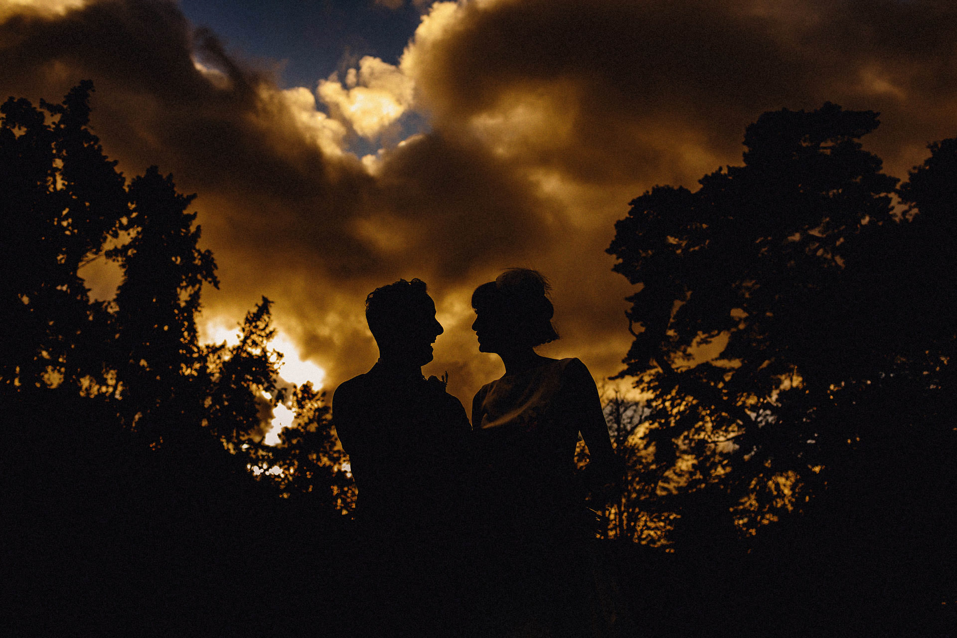 silhouette of the bride and groom outside the church